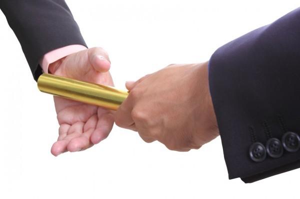 businessman send golden boton