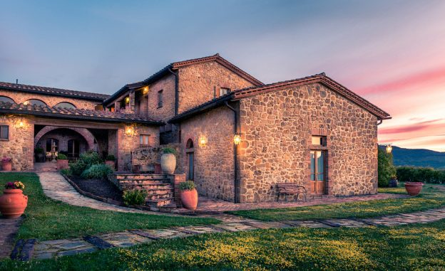 PIENZA ITALY - JUNE 21 2015: beautiful renovated tuscan manor at sundown near historic Pienza town in Italy